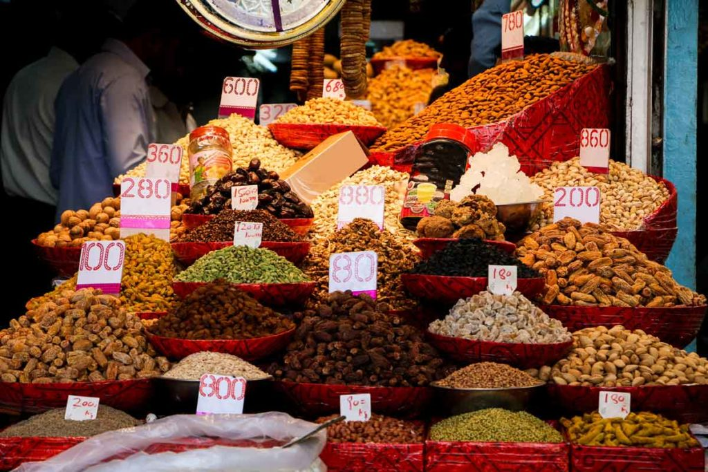 Dry fruits in different colours on a stall
