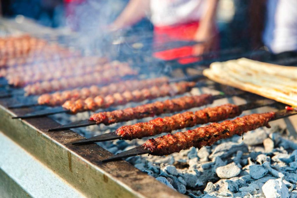 Kebab on grill with skewers in Istanbul as one of the best cities for foodies