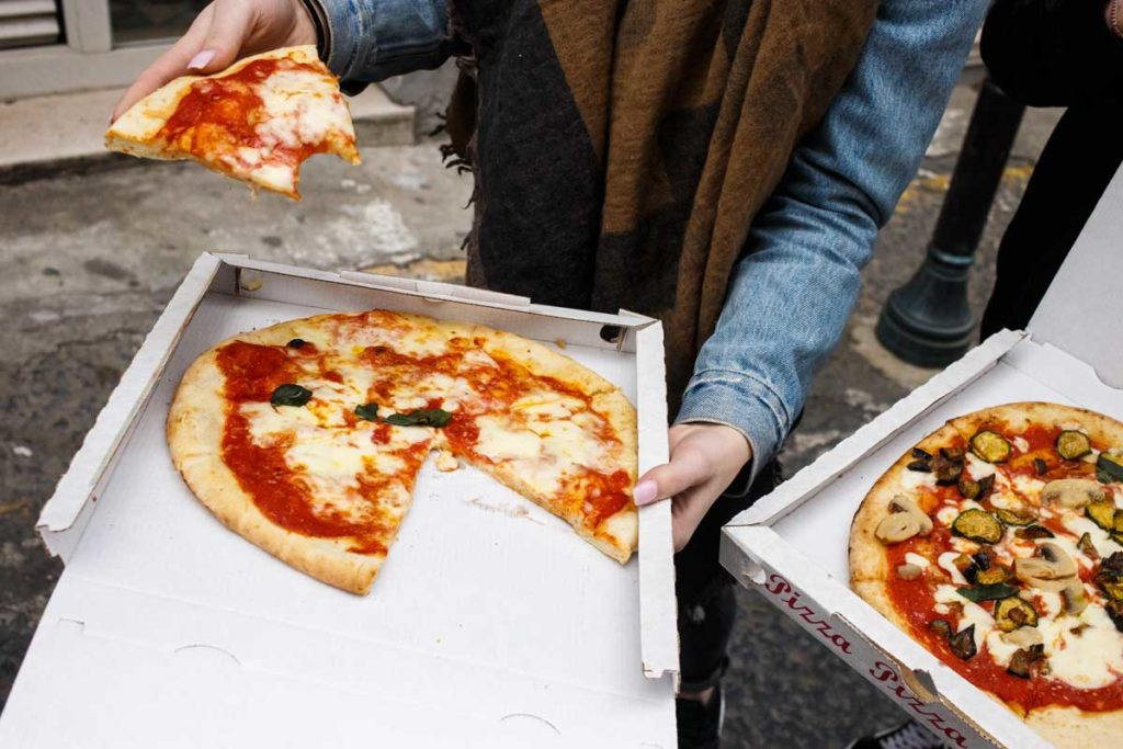 Pizza for take-away in Naples, one of the best cities for foodies