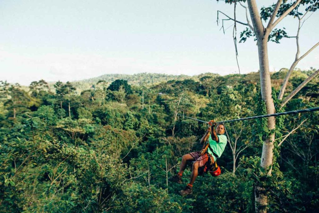 Zip line with man over a jungle in Costa Rica
