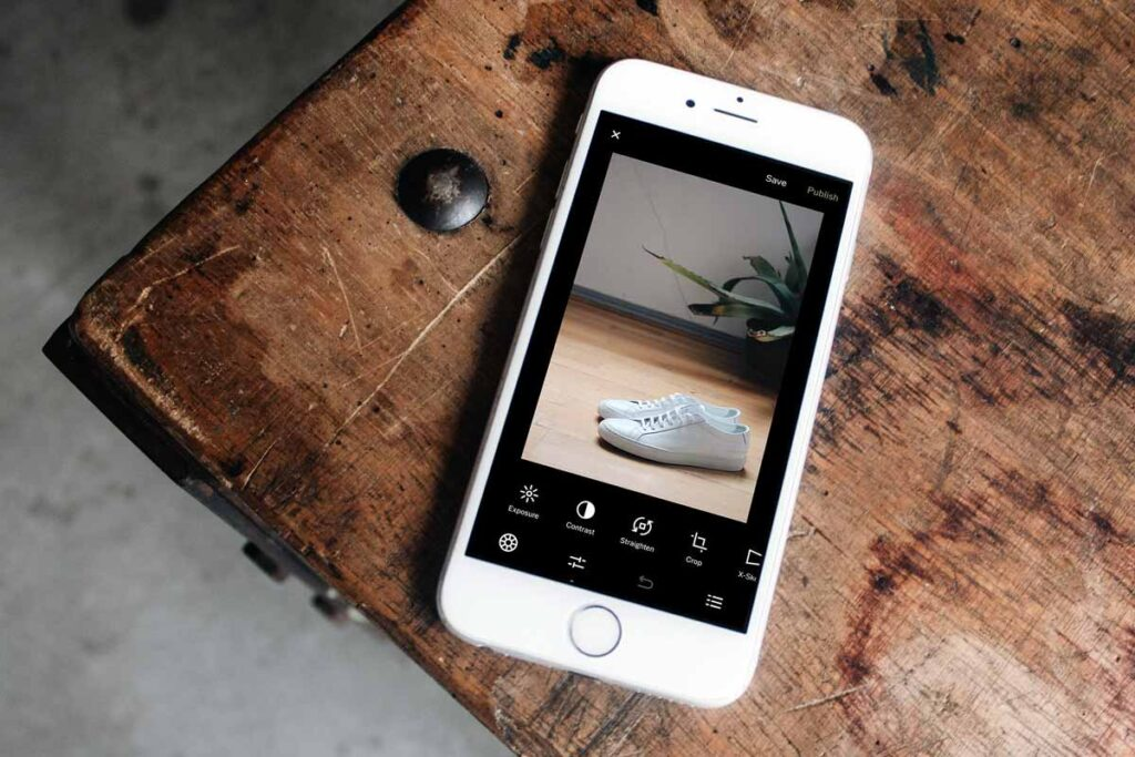 the iPhone camera app VSCO is open on the wooden table