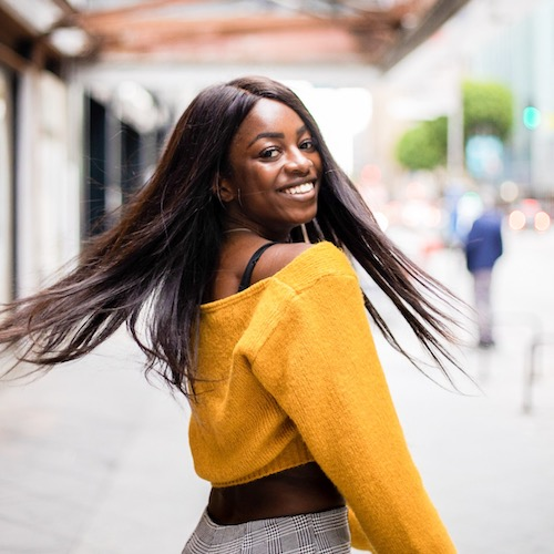 Efia Sulter abroad smiling in yellow top
