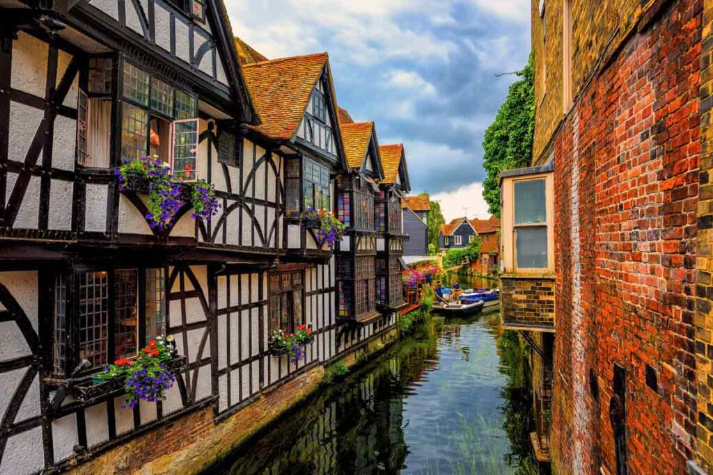 Medieval buildings look over a canal in Canterbury