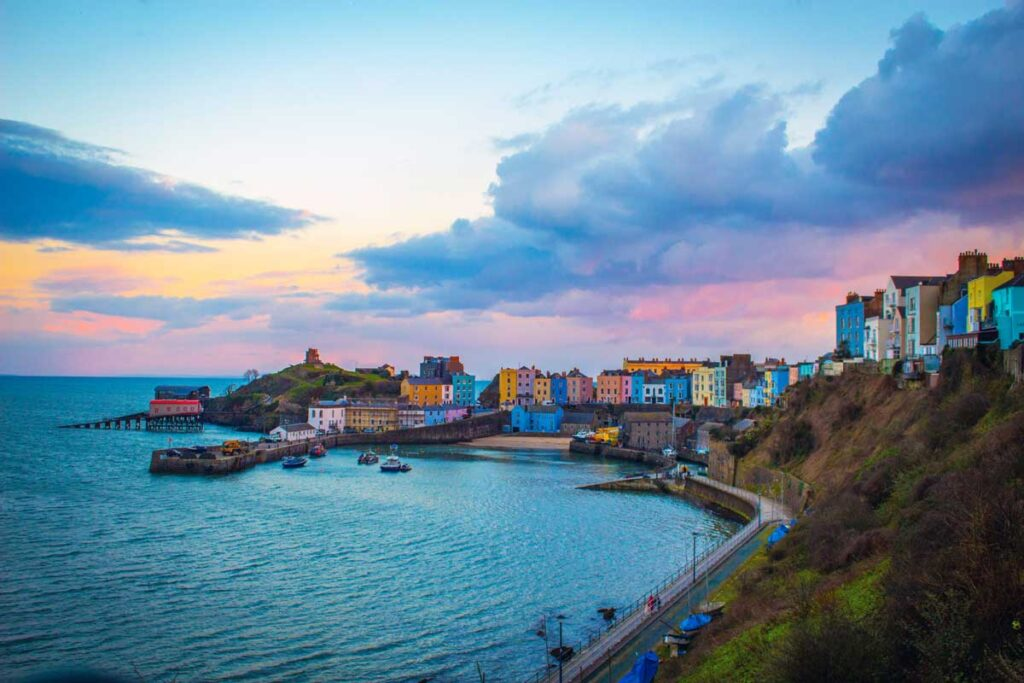 Colourful houses and colourful skies in Tenby make this getaway near London popular
