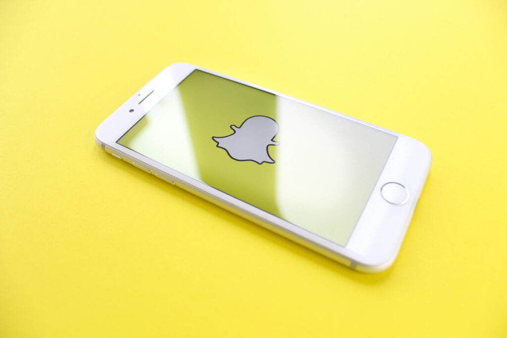snapchat as one of the apps to stay connected on a yellow background