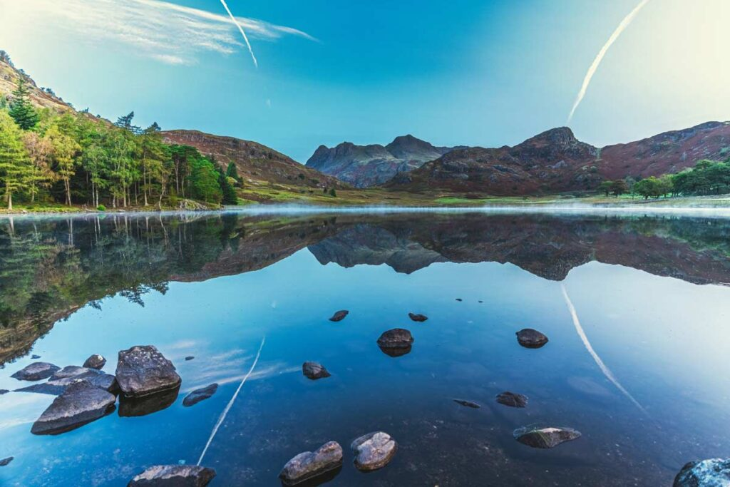 A blue lake with rocks in The Lake District is one of the best rural British landscapes to visit