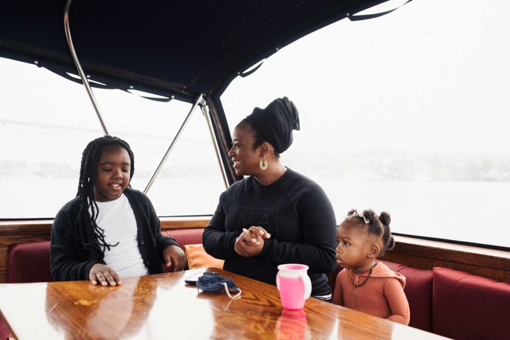 Family with kids discussing on a boat