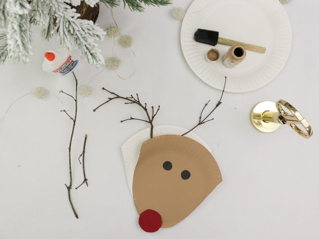 Step 6 in making a Rudolph plate with the children - glue the plate shapes to each other