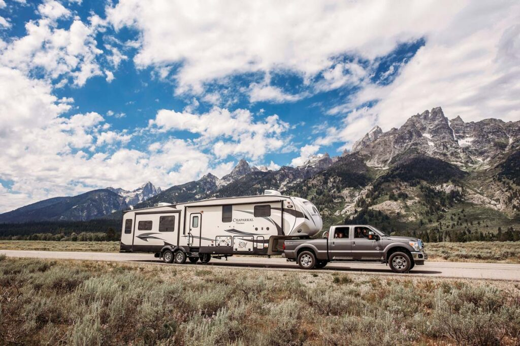 Rv and car in front of stunning scenery