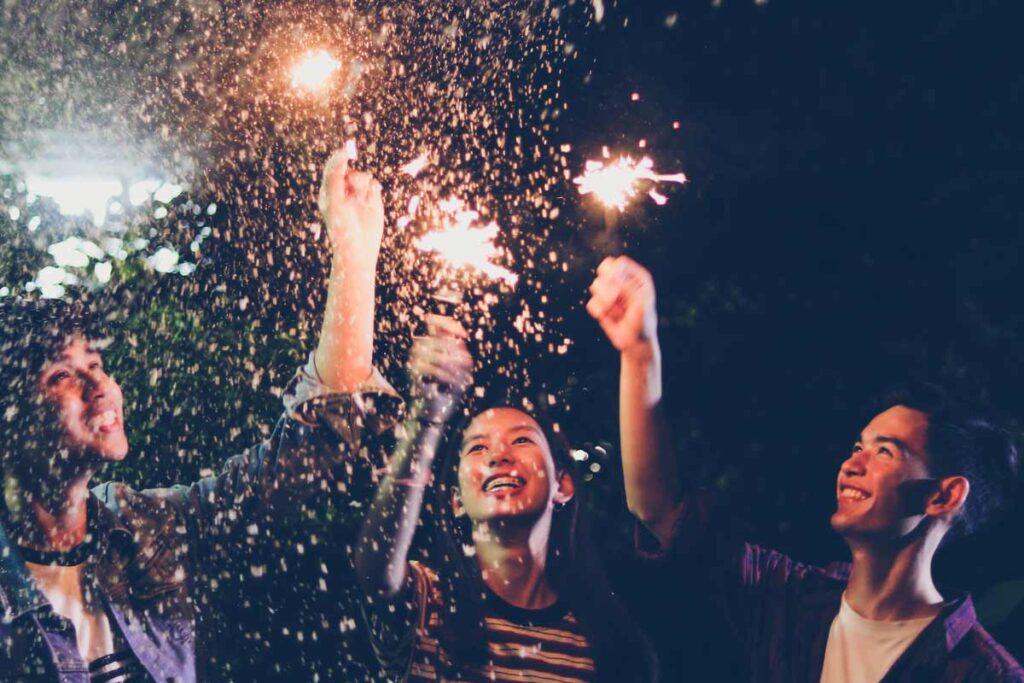 Three friends celebrate with alternative new year's eve ideas