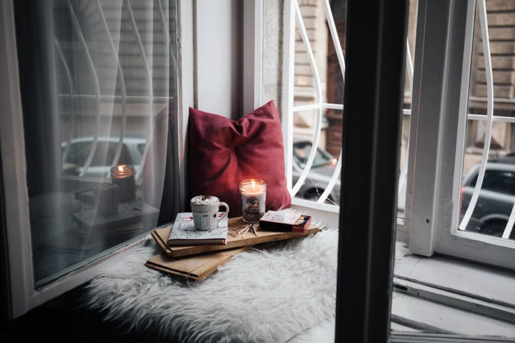 New Year's Resolutions ideas should involve a comfy spot like this, candles and self love